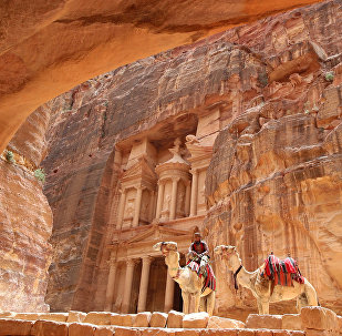 A Jordanian Bedouin sits on a camel in front of the Treasury Building in the ancient city of Petra in Jordan on May 9, 2016