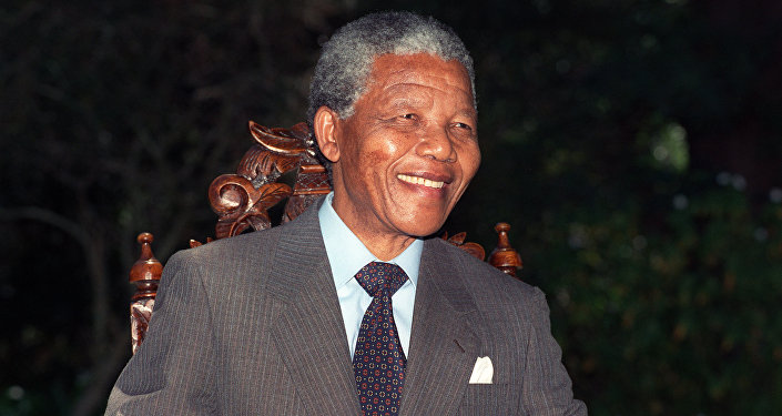 Anti-apartheid leader and African National Congress (ANC) member Nelson Mandela smiles during a photo session after his first press conference since his release from jail, 12 February 1990 in Cape Town. (File)