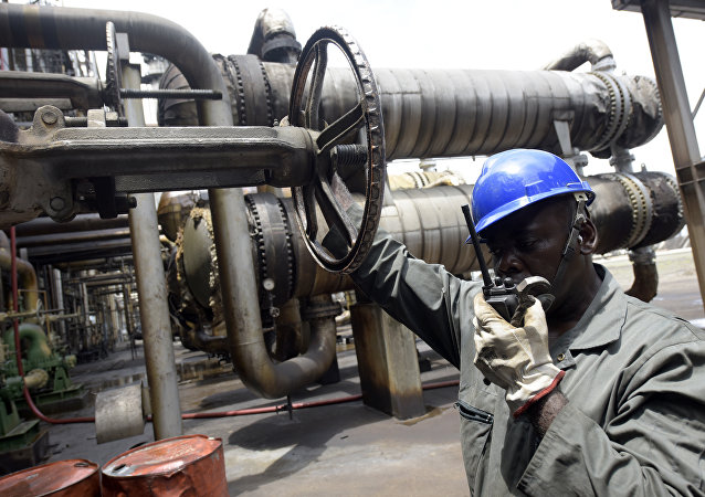 Worker speaks to the control room at the new Port Harcourt refinery built in 1989 at the same site where the first refinery in Nigeria was built in 1965 in oil rich Port Harcourt, Rivers State, on September 16, 2015