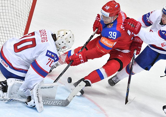 The Norwegian team's goalkeeper Steffen Soberg, Russia's player Stepan Sannikov and Norway's player Mattias Norstebo seen in the World Ice Hockey Championship's match between Russia and Norway