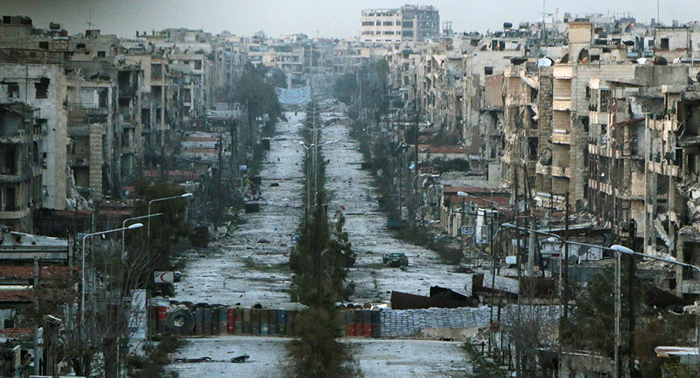 A general view shows a damaged street with sandbags used as barriers in Aleppo's Saif al-Dawla district (File)