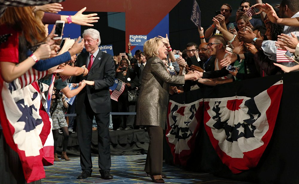 Democratic U.S. presidential candidate Hillary Clinton and her husband greet supporters.
