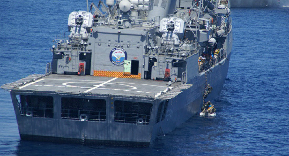 Tunisian navy maritime interdiction operations team practices boarding and search techniques aboard the Tukish navy frigate TCG Turgutreis (F 241) as part of Exercise Phoenix Express 2015, May 19