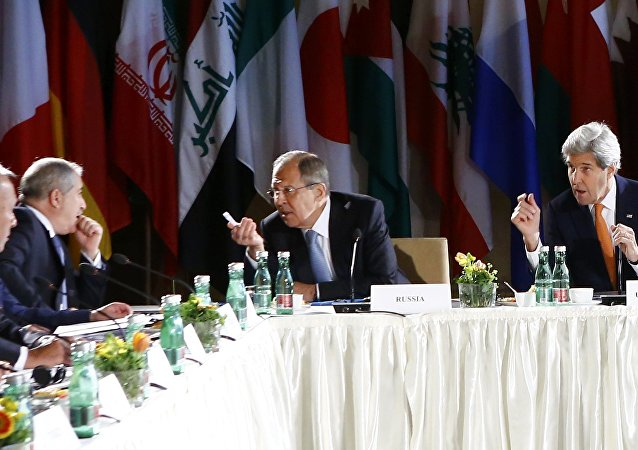 Russian Foreign Minister Sergei Lavrov (2ndR) and US Secretary of State John Kerry (R) lead talks on Syria on May 17, 2016 in Vienna