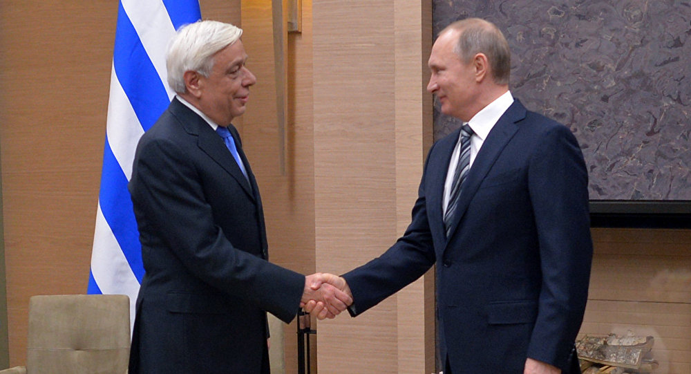 Russian President Vladimir Putin meets with Greek counterpart Prokopis Pavlopoulos. file photo