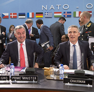 NATO Secretary General Jens Stoltenberg, right, and Montenegro's Prime Minister Milo Dukanovic, left, take their seats during a meeting of the North Atlantic Council and Montenegro at NATO headquarters in Brussels on Thursday, May 19, 2016