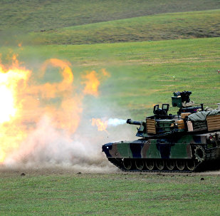 A US M1A2 Abrams tank fires during the Noble Partner 2016 joint military exercise at the Vaziani training area outside Tbilisi on May 18, 2016.