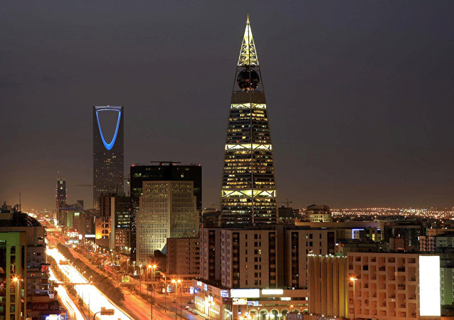Saudi Arabian city view with the 'Kingdom Tower', background, and 'Al-Faislia Tower' in Riyadh. (File)