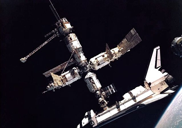Space Shuttle Atlantis docked with the Russian Mir Space Station