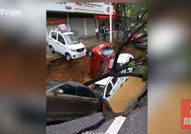 Monstrous Sinkhole Swallows Cars and Tree in China