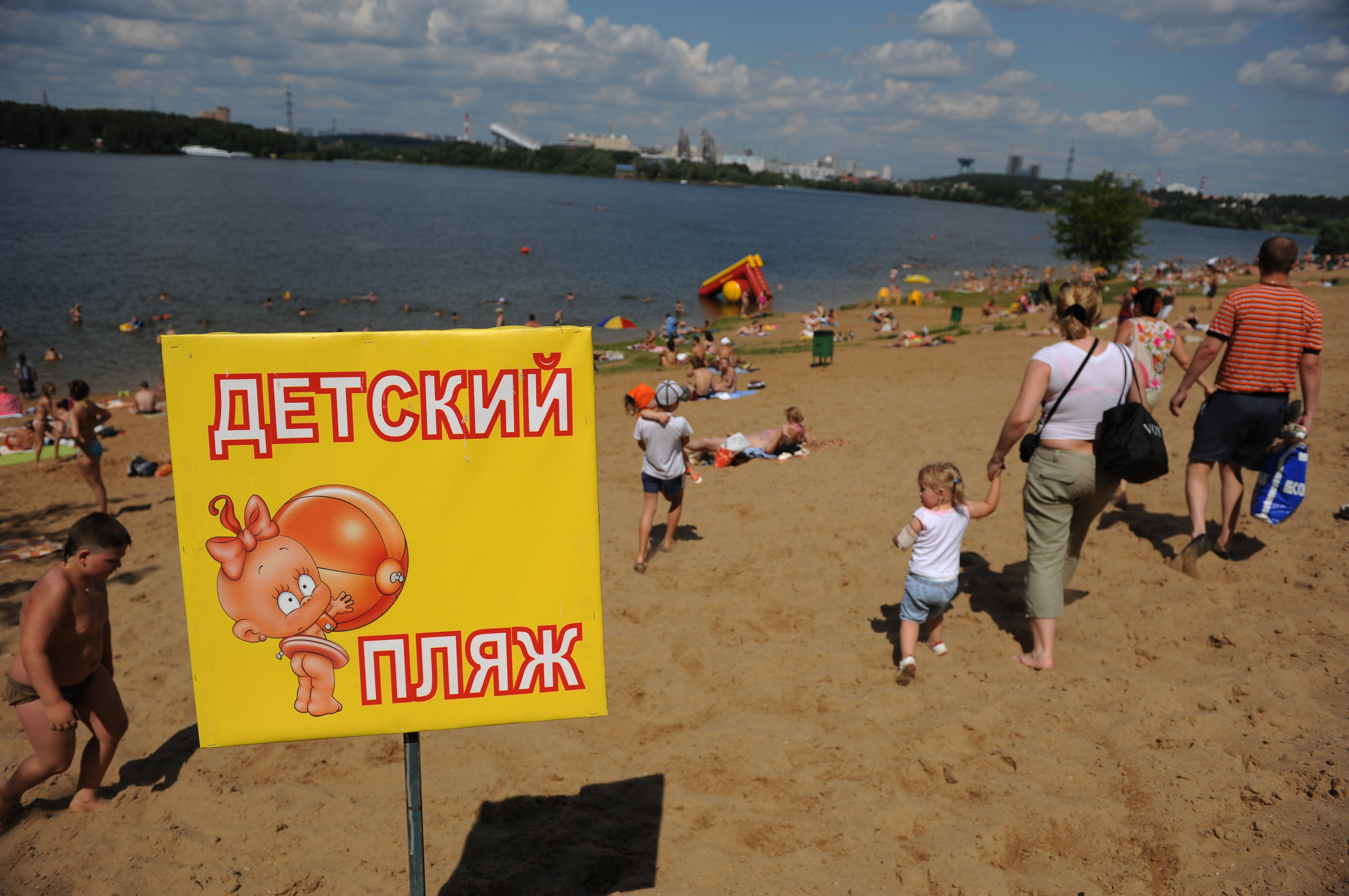 People Relaxing At Moscows Rublyovo Beach