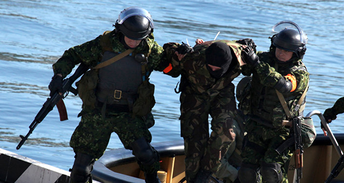 Servicemen deliver a detained terrorist during exercises of forces of the Maritime Territory Counter-Terrorism Operation Headquarters, Vladivostok