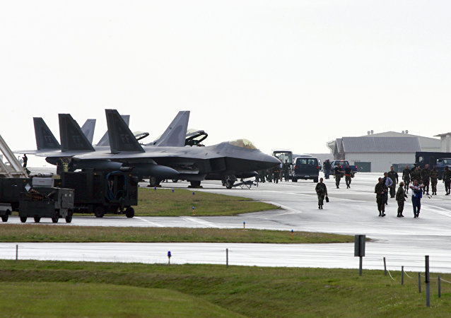 US Air Force's new stealth fighters F-22A Raptor (L) are lined up at the Kadena US Air Base, in Kadena town (File)