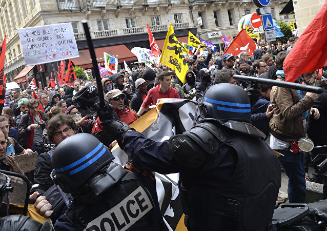 Security forces clash with demonstrators during a protest called by seven labour unions and students against the labour and employment law reform on May 26, 2016 in Bordeaux, southwest France