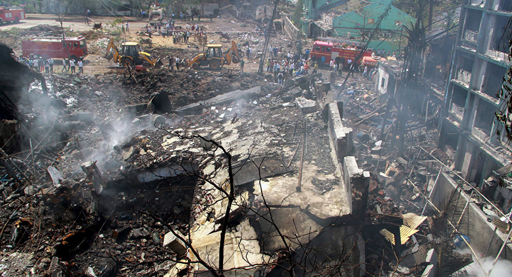 Indian rescue teams gather at the site of an explosion and fire that destroyed a chemical plant in Mumbai on May 26, 2016