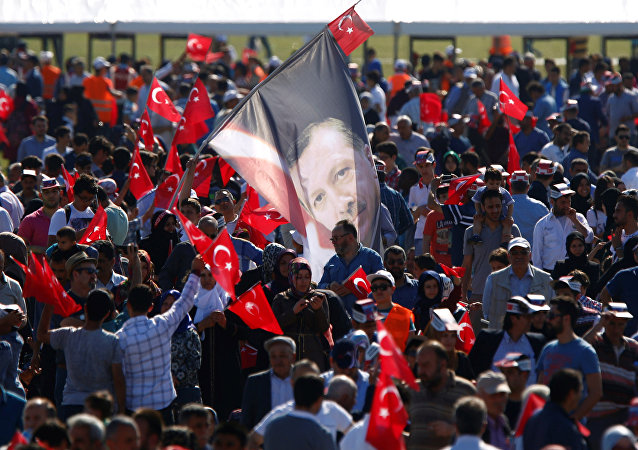 A man waves a flag with the image of Turkish President Tayyip Erdogan during a rally to mark the 563rd anniversary of the conquest of the city by Ottoman Turks, in Istanbul, Turkey, May 29, 2016.