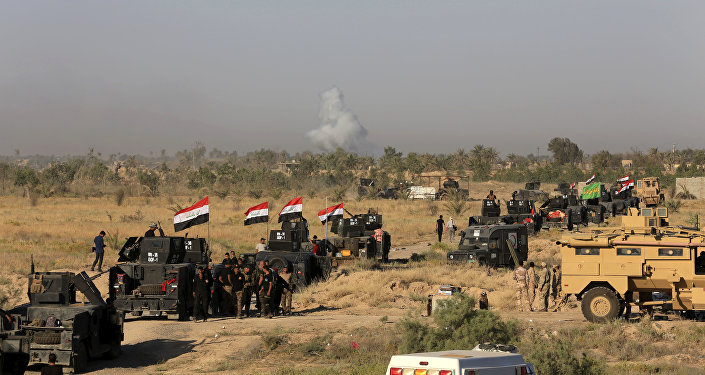 Smoke rises as Iraqi military forces prepare for an offensive into Fallujah to retake the city from Islamic State militants in Iraq, Monday, May 30, 2016