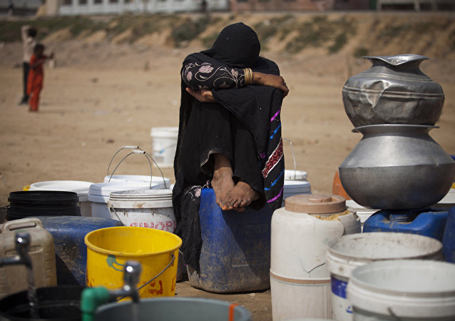 Pakistani nomad girl waits for her turn to fetch fresh water at Rawalpindi's slums in Pakistan. (File)