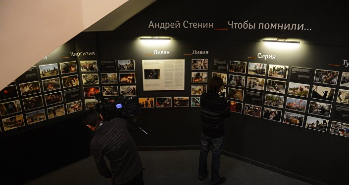 Journalists by the photo exposition of Andrei Stenin, a photo correspondent of the Rossiya Segodnya news agency, who was killed in Ukraine while performing his professional duty.