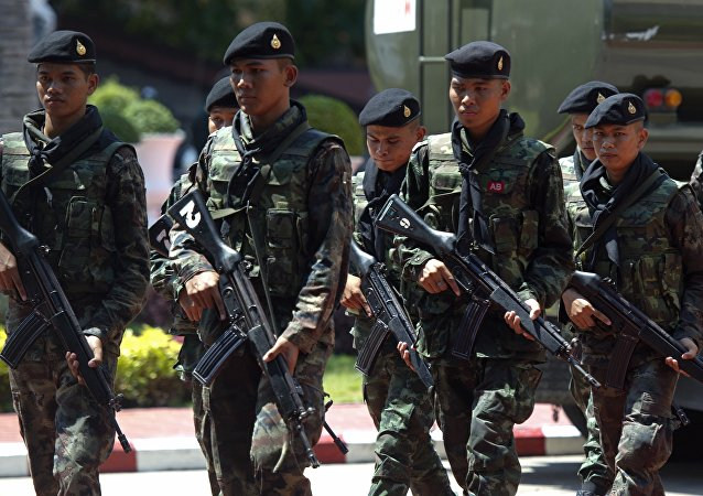 Thai soldiers patrol prior to Thai army chief General Prayut Chan-O-Cha's press conference at the Army headquarters in Bangkok on May 26, 2014