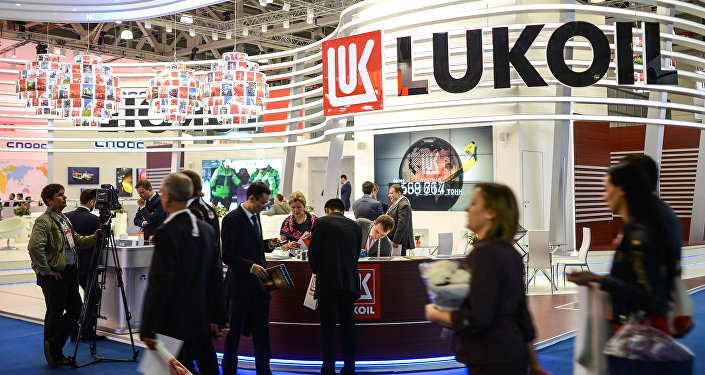Visitors near the Lukoil display at the World Petroleum Exhibition held at Crocus Expo International Exhibition Center. File photo