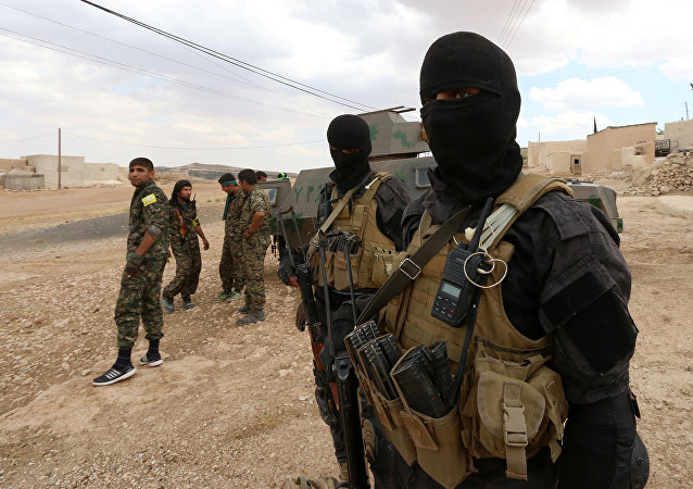 Special forces from the Syria Democratic Forces gather in a village, after taking control of it from Daesh, in the southern rural area of Manbij, in Aleppo Governorate, Syria