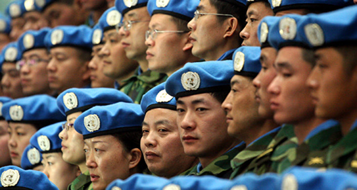 Chinese peacekeepers prepare to depart for their United Nations mission to Sudan from an airport in Zhengzhou, central Chinas Henan province, in this Tuesday, Jan. 16, 2007 file photo