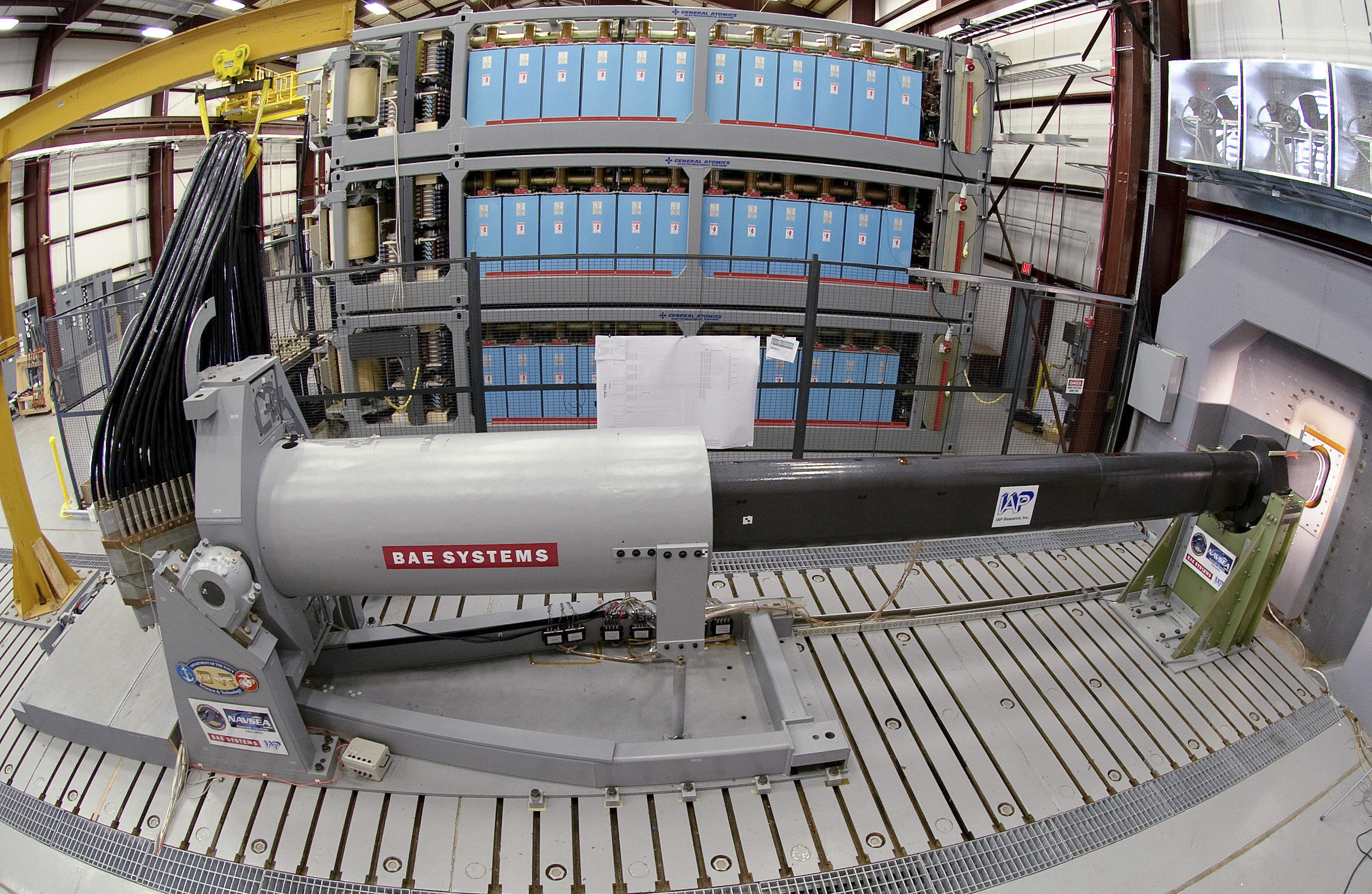 This Thursday Feb. 23. 2012 photo provided by the US Navy shows engineers at Naval Surface Warfare Center, Dahlgren Division, prepare to test the Office of Naval Research-funded electromagnetic railgun prototype launcher that was recently installed at a test facility in Dahlgren, Va.