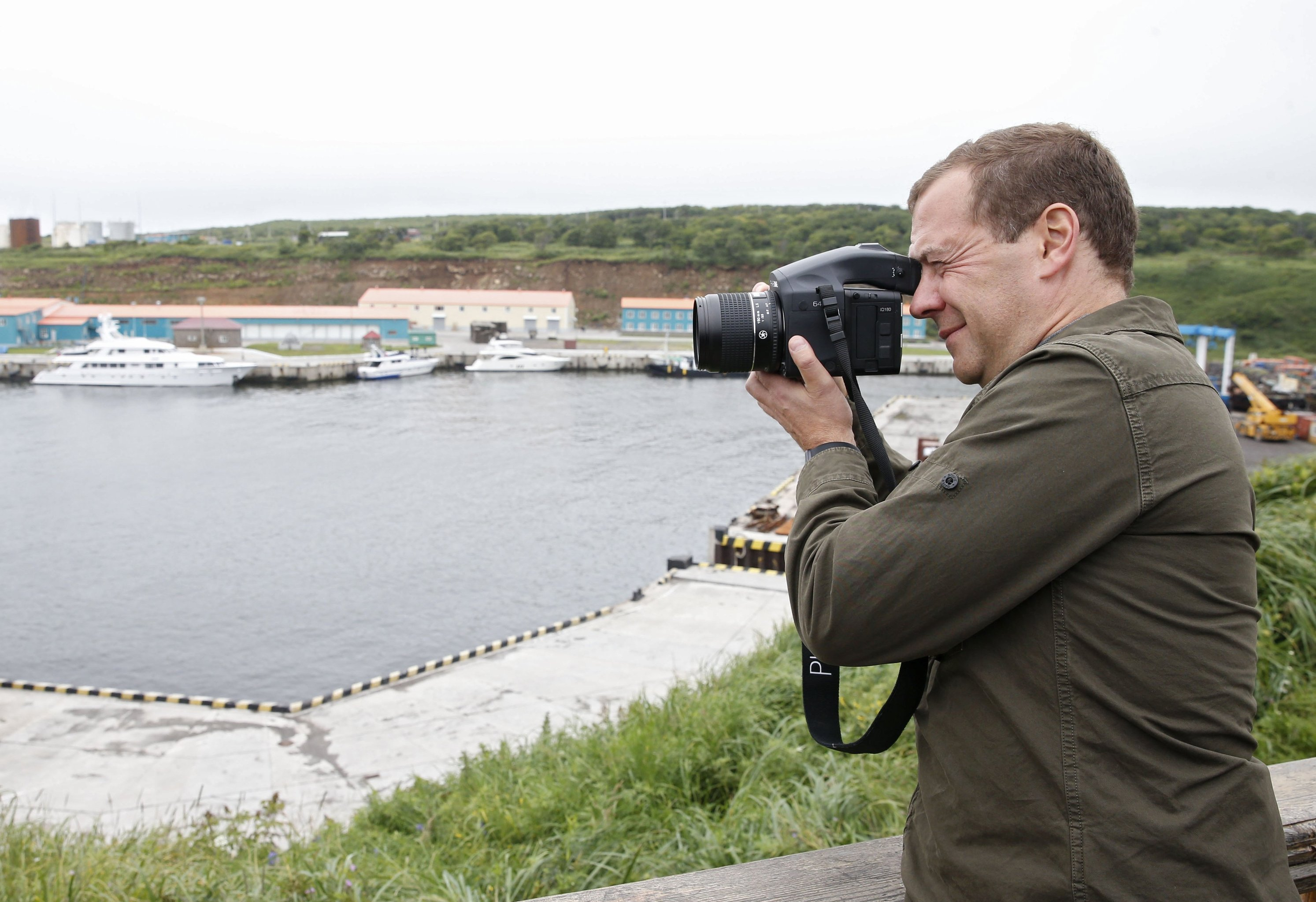 Russian Prime Minister Dmitry Medvedev on a tour of the Kurilsky port station in the township of Kitovy on Iturup, one of the Kuril Islands. (File)