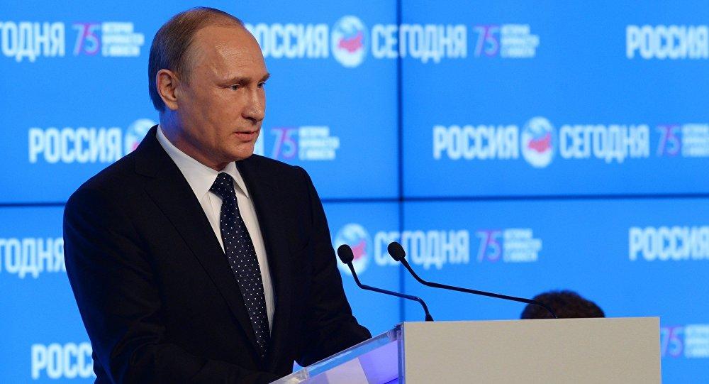 Russian President Vladimir Putin speaks at the New Era of Journalism: Farewell to Mainstream international media forum at the Rossiya Segodnya International Multimedia Press Center