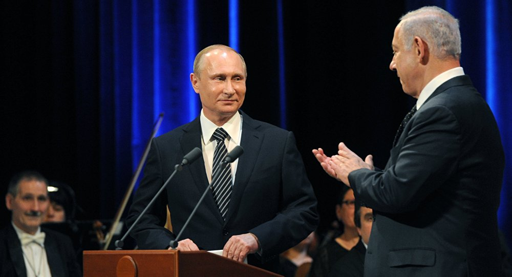 June 7, 2016. Russian President Vladimir Putin (left) and Israeli Prime Minister Benjamin Netanyahu before a concert devoted to the 25th anniversary of the restoration of Russian-Israeli diplomatic relations in the Bolshoi Theater.