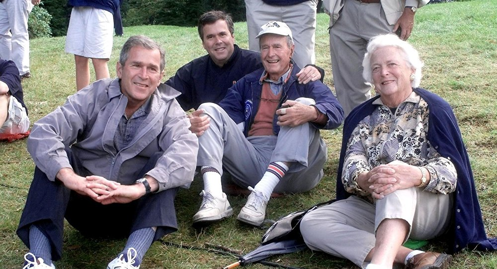 The Bush family,(L-R) Texas Governor and presidential candidate George W., Florida Governor Jeb, former US president George and his wife Barbara watch play during the Foursomes matches 25 September 1999 at The Country Club in Brookline, Massachusetts the site of the 33rd Ryder Cup Matches