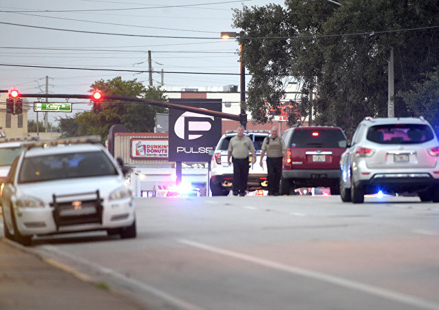 Police cars surround the Pulse Orlando nightclub, the scene of a fatal shooting, in Orlando, Fla., Sunday, June 12, 2016