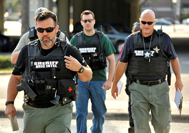 Officers arrive at the Orlando Police Headquarters during the investigation of a shooting at the Pulse nightclub, where people were killed by a gunman, in Orlando, Florida, U.S June 12, 2016