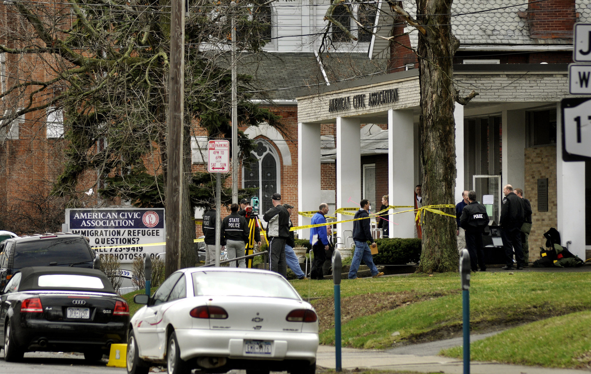Law enforcement personnel investigate outside the American Civic Association, Friday, April 3, 2009, in Binghamton, N.Y.