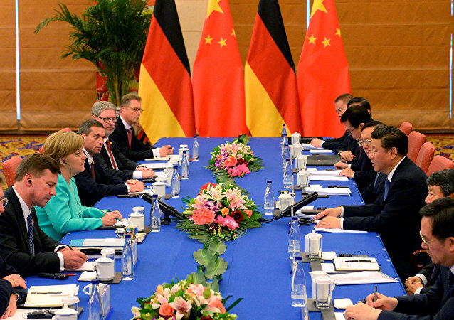 German Chancellor Angela Merkel (3rd L) attends a meeting with Chinese President Xi Jinping (3rd R) at Beijing Hotel, in Beijing, China, June 13, 2016.