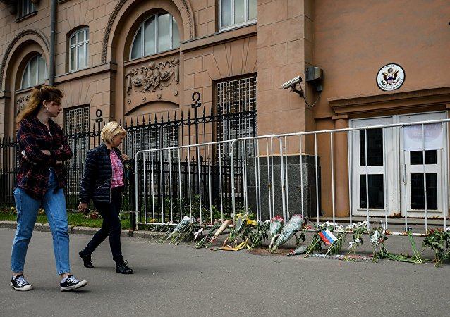 Flowers left outside the US Embassy in Moscow in memory of those killed in the night club shooting in Orlando