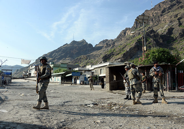 Afghan border police stand guard near the Torkham crossing between Afghanistan and Pakistan in Nangarhar province on May 12, 2016.
