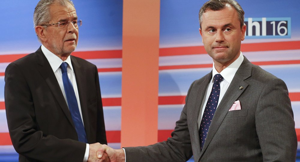 Presidential candidates Norbert Hofer of the Freedom Party (FPO) and Alexander Van der Bellen (L) who is supported by the Greens party, shake hands before a TV debate.