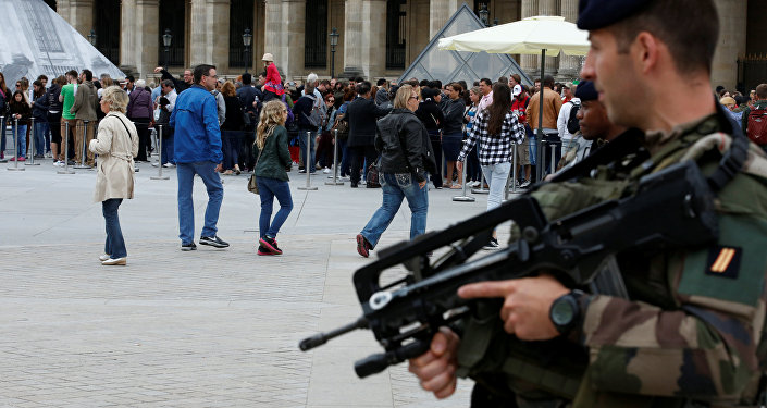French army soldiers patrol as tourists form a queue at the entrance of the Louvre museum in Paris, France as the French capital is under high security during the UEFA 2016 European Championship
