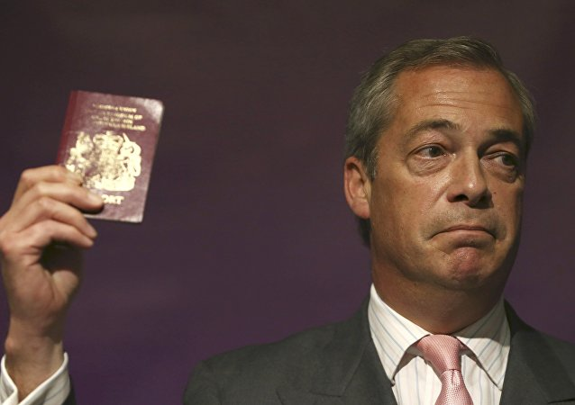 Leader of the United Kingdom Independence Party (UKIP) Nigel Farage holds his passport as he speaks at pro Brexit event in London, Britain June 3, 2016.