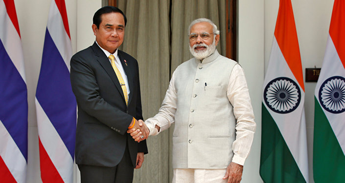 Thailand's Prime Minister Prayuth Chan-ocha (L) shakes hands with his Indian counterpart Narendra Modi during a photo opportunity at Hyderabad House in New Delhi, India, June 17, 2016