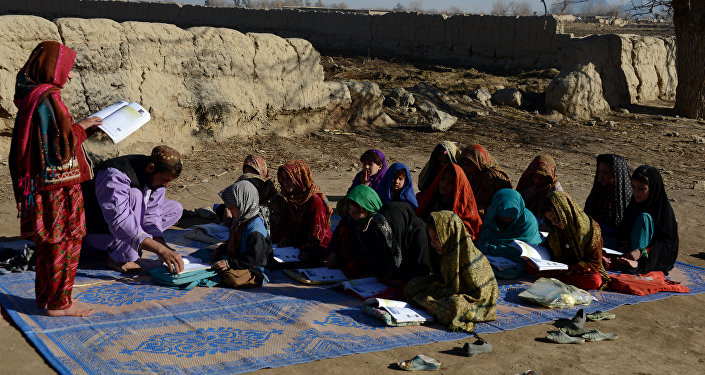 Afghan schoolchildren study at an open-air classroom in the Panjwai district of Kandahar province