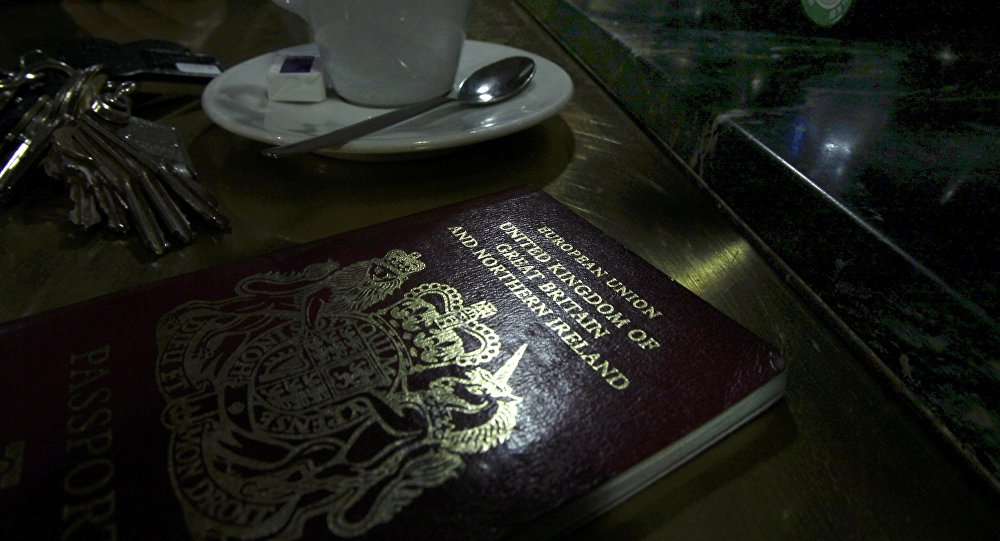 File photo illustration shows a European Union British Passport on the counter of a cafe in Paris.