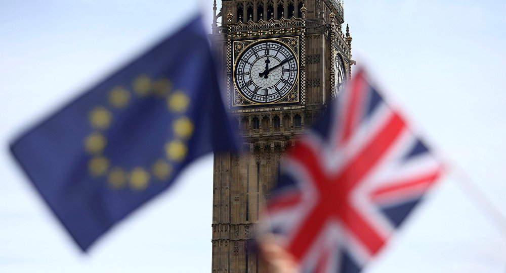 Participants hold a British Union flag and an EU flag during a pro-EU referendum event at Parliament Square in London.