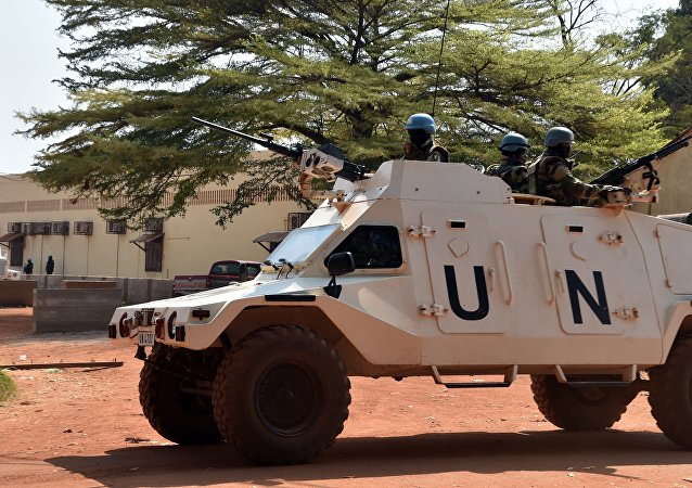 United Nations peacekeepers patrol outside a vote-counting centre for the presidential and parliamentary elections on January 2, 2016 in Bangui