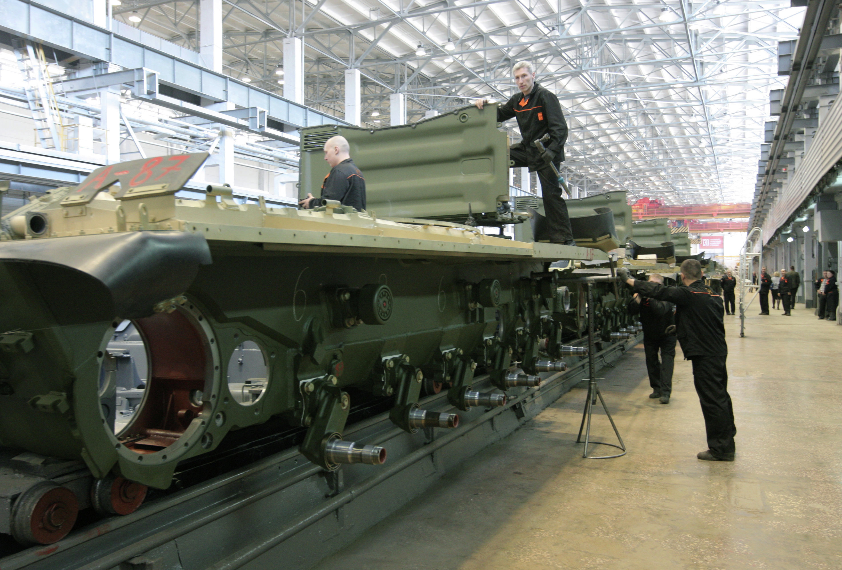 Workers of the JSC Uralvagonzavod assemble tanks on the production floor. In addition to its military production, the company is one of the largest scientific and industrial complexes in Russia.