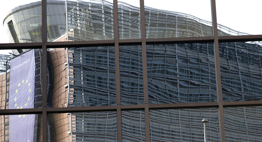 European Union headquarters is reflected in the windows of the EU Council building prior to an EU summit in Brussels on Tuesday, June 28, 2016.