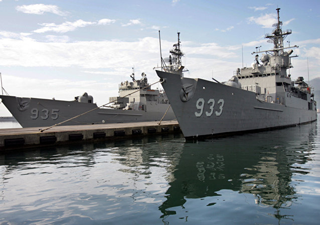 Two Taiwan Navy Knox-class frigates prepare to embark from Taiwan's eastern coastal port of Suao.