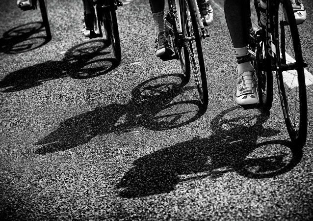 Cyclists ride during the 223.5 km fourth stage of the 102nd edition of the Tour de France cycling race on July 7, 2015, between the Belgian city of Seraing and Cambrai, northern France.